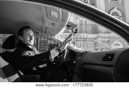 Businessman Waving Someone Out Of The Car By His Hand, Outdoor, Day