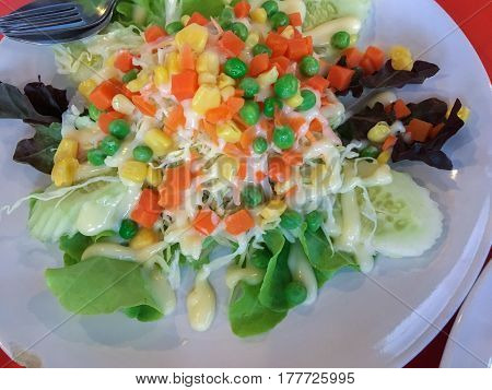close up salad with vegetables and greens. Vegetable salad healthy food. Vegetable salad bowl isolated on white.
