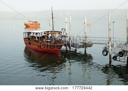 TIBERIAS ISRAEL - FEBRUARY 27 2017: Pleasure boat at the quay on the Kinneret lake on a misty morning