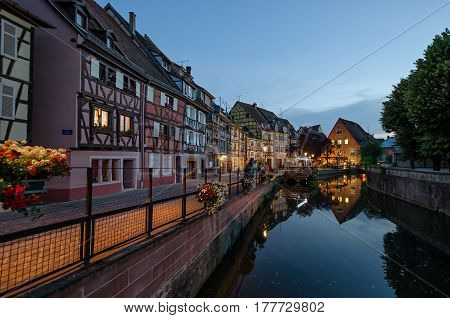 Quay channel in the city of Colmar. Alsace. France. There are colorful facades of old half-timbered houses.