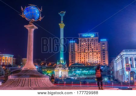 KYIV, UKRAINE - MARCH 23, 2017: Maidan Nezalezhnosti (literally: Independence Square) is the central square of the capital city of Ukraine with people in the night time. Vivid, splittoned image.
