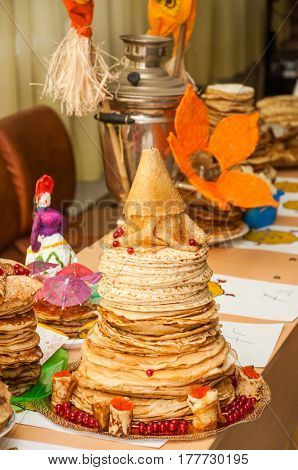 Most of the original mountain of pancakes during the celebration Russian Shrovetide (pancake week)