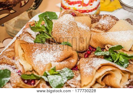 A variety of original pancakes in the contest during the celebration Russian Shrovetide (pancake week) at school. the view from the top