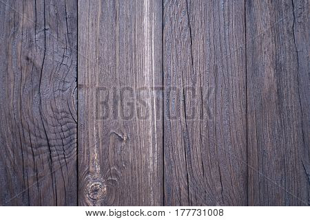 Old grunge dark brown wood panel pattern with beautiful abstract grain surface texture, striped background or backdrop in architectural material decoration concepts, vintage or retro style