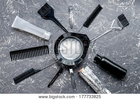 hair care concept with dye tools in barbershop on gray table background top view