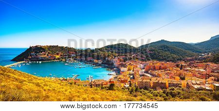 Porto Ercole village and boats in harbor in a sea bay. Panoramic aerial view. Monte Argentario Maremma Grosseto Tuscany Italy