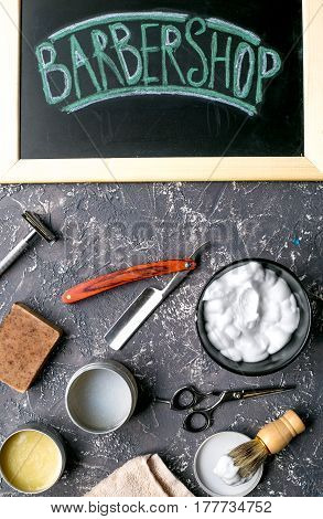 babrer workplace with tools for shaving on gray table background top view
