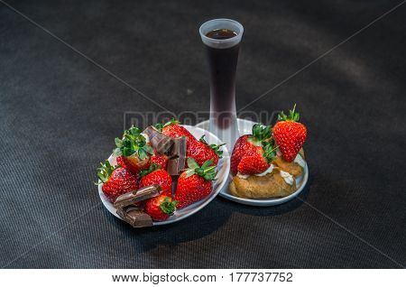 Liqueur  In Glass, Strawberries With Pieces Of Chocolate On A White Saucer