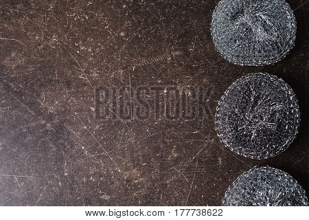 Metal sponges on a dark marble background. Items for hygiene and washing dishes. Metal sponges concept