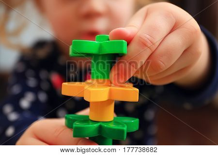 Kid Building Tower With Constructor