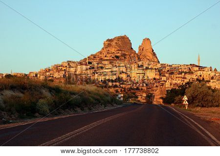Travel To Goreme, Cappadocia, Turkey. The View On The City With The Road On The Foreground.