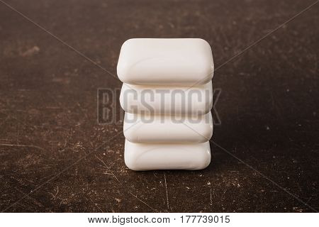 White soap on a dark marble background. Personal care. Hygiene with soap. White soap concept. Soap on table