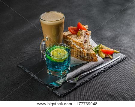 Set Consisting Of Two Sandwiches Malted Bread With Smoke Flavor Becon, Pickles, Mayonnaise, Tomato,