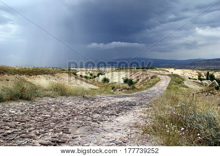 Travel To Cappadocia, Turkey. The Cloudy And Rainy Weather In The Mountains.