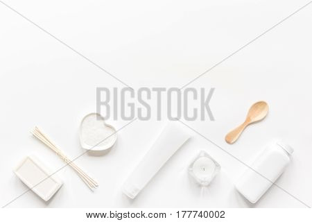 bodycare concept with monochrome set of cosmetics for homemade spa on white woman desk background top view mock-up