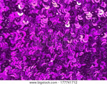 Sparkling purple sequin textile background and texture