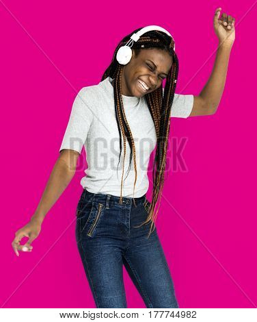 African descent girl is listening to music