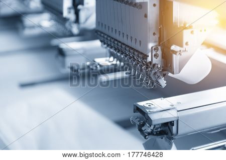 The industry sewing machine in the light blue scene with lighting effect