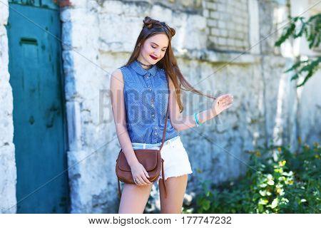Beautiful teenage girl posing outdoor