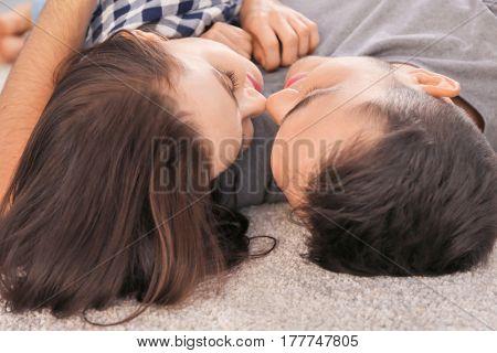 Happy couple hugging on floor