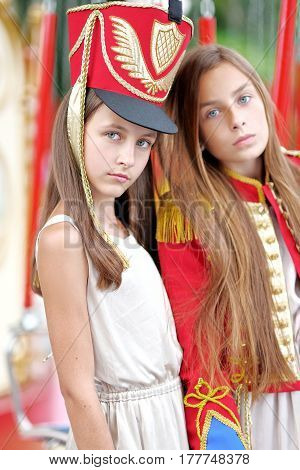 Portrait Of Two Girls In The Style Of Hussars