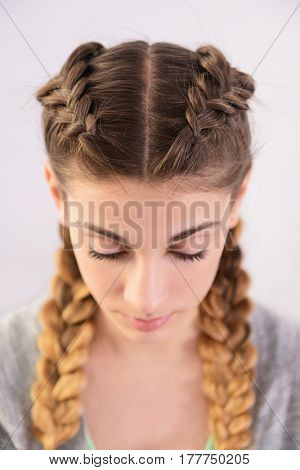 Young woman with beautiful hairstyle on light background