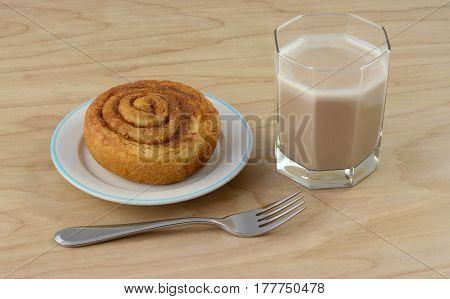 Quick breakfast of cinnamon roll and chocolate kefir milk