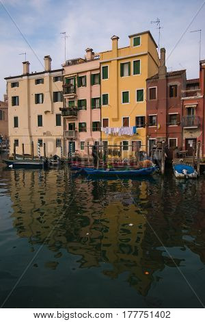 Photo of fisher boats on Chioggia canal, Italy