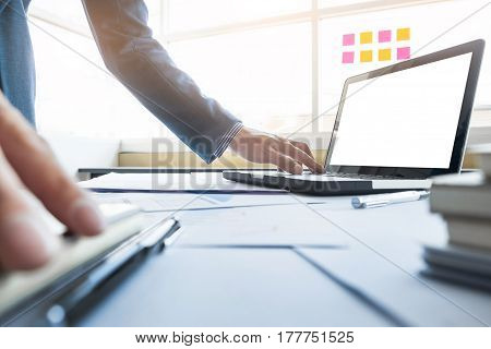 Casual Businessman Working In Office, Sitting At Desk, Typing On Keyboard, Looking At Computer Scree