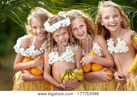 Portrait Of Four Girls In A Tropical Style