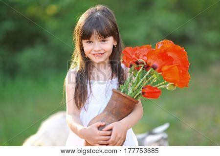 Portrait Of A Beautiful Little Girl With Poppy