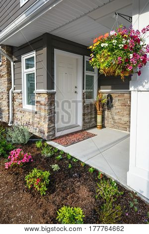 Entrance of brand new townhome decorated with flowers
