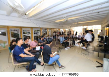 Education Concept, Blurred Students Studying In Large Outdoor Hall Open Air With Professional Keynot