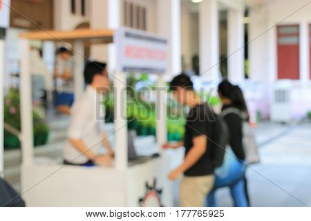 Blurred Image Of Education People Looking At The Exhibition In The University.