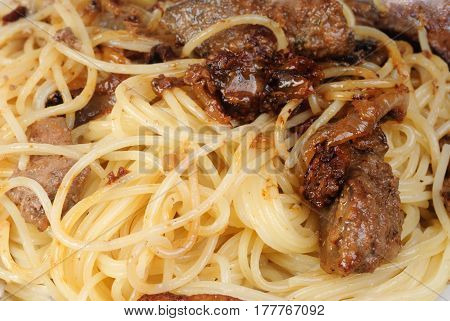 Liver or meat and spagetti -fine food background