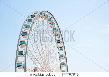Close up Giant Ferris Wheel in Hong Kong near Victoria Harbor with clear sky backgroundHong Kong