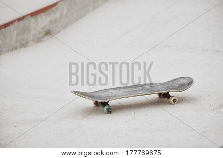 skateboard at skatepark ready for riding on concrete background