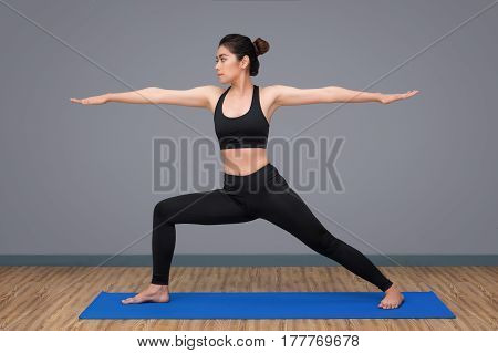 Young Asian Woman Practicing Yoga Pose At Yoga Healthy Sport Gym, Yoga And Meditation Have Good Bene