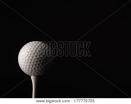 Close up of a golf ball on a black background