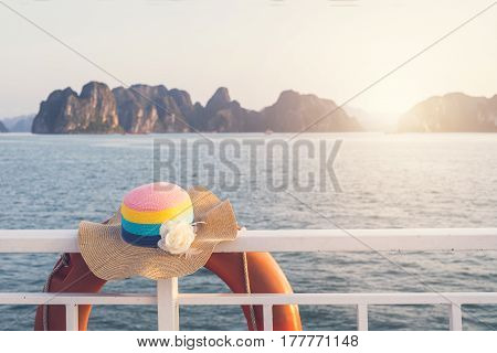 Hat on boat with landscape view and sunlight