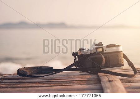 Retro camera with beautiful landscape at the sea