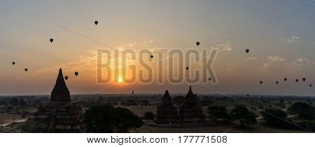 Beautiful sunrise scene of Ancient Pagoda with hot air balloon in Bagan Myanmar