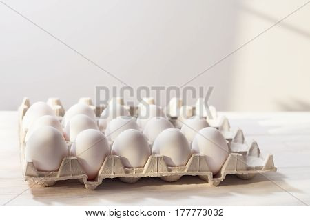 Eggs, White Background, Table, Packaging For Eggs Made Of Cardboard