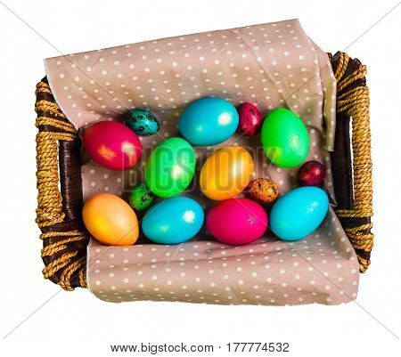 Easter card. Painted eggs of chicken and quail in basket. Isolated on white. Top view from above copy space.