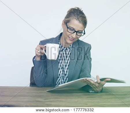 Office Worker Drinking Coffee Reading Book
