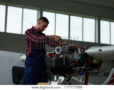 Modern engineer carrying out fixing work