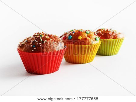 Three delicious sweet cupcakes. Tasty homemade muffins. Shallow depth of field. Selective focus.