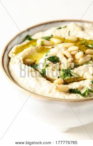 Classic Hummus With Herbs, Olive Oil In A Vintage Ceramic Bowl.
