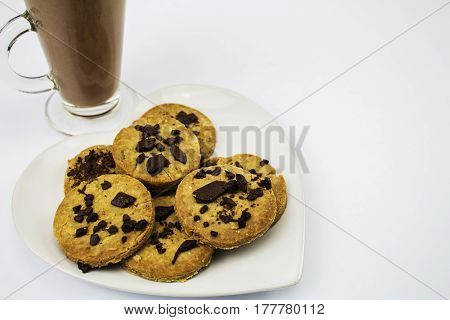 A plate of Gluten free Organic Homemade Chocolate Chip Cookies with a glass of Hot chocolate - Cocoa