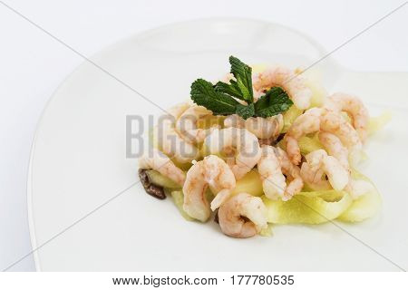 Prawns - Shrimps with melon anchovies and a garnish of mint.